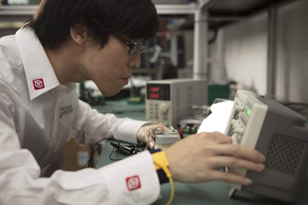 Precision Microdrives engineer is testing a motor using bespoke equipment